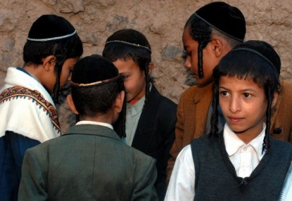 Yemeni Jewish boys attend at the wedding party of 19-year-old Yemeni Jew, Yussef Saeed Hamdi (not in picture), in the village of Raydah in Yemen's Amran province, 70 kms north of Sanaa, on June 15, 2008. Hamdi is completing his studies in Jerusalem but he came back home to get married to a young woman from his community, according to relatives. A few hundred Jews still live in Yemen, but recent threats by rebels from the Zaidi minority made some leave their homes in the Saada province to the Sanaa region. Jews, like Muslims in tribal areas of Yemen, hold three-day wedding parties for their children who usually marry members of the same community. AFP PHOTO/KHALED FAZAA (Photo credit should read KHALED FAZAA/AFP/Getty Images)