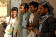 Yemeni Muslim and Jewish (R and 2nd L) guests attend the wedding party of 19-year-old Yemeni Jew, Yussef Saeed Hamdi (not in picture), in the village of Raydah in Yemen's Amran province, 70 kms north of Sanaa, on June 15, 2008. Hamdi is completing his studies in Jerusalem but he came back home to get married to a young woman from his community, according to relatives. A few hundred Jews still live in Yemen, but recent threats by rebels from the Zaidi minority made some leave their homes in the Saada province to the Sanaa region. Jews, like Muslims in tribal areas of Yemen, hold three-day wedding parties for their children who usually marry members of the same community. AFP PHOTO/KHALED FAZAA (Photo credit should read KHALED FAZAA/AFP/Getty Images)
