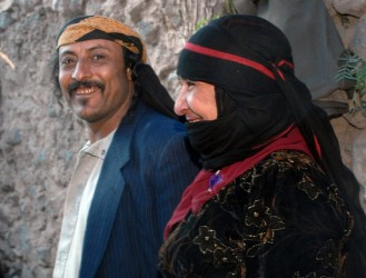 The parents of 19-year-old Yemeni Jew Yussef Saeed Hamdi pose for a picture on the first day of the traditional wedding party of their son in the village of Raydah in Yemen's Amran province, 70 kms north of Sanaa, on June 15, 2008. Hamdi is completing his studies in Jerusalem but he came back home to get married to a young woman from his community, according to relatives. A few hundred Jews still live in Yemen, but recent threats by rebels from the Zaidi minority made some leave their homes in the Saada province to the Sanaa region. Jews, like Muslims in tribal areas of Yemen, hold three-day wedding parties for their children who usually marry members of the same community. AFP PHOTO/KHALED FAZAA (Photo credit should read KHALED FAZAA/AFP/Getty Images)