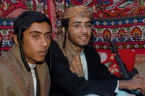 With a kalashnikov on his side, 19-year-old Yemeni Jew, Yussef Saeed Hamdi (R), poses for a picture with an unidentified guest on the first day of his traditional wedding party in the village of Raydah in Amran province, 70 kms north of Sanaa, on June 15, 2008. Hamdi is completing his studies in Jerusalem but he came back home to get married to a young woman from his community, according to relatives. A few hundred Jews still live in Yemen, but recent threats by rebels from the Zaidi minority made some leave their homes in the Saada province to the Sanaa region. Jews, like Muslims in tribal areas of Yemen, hold three-day wedding parties for their children who usually marry members of the same community. AFP PHOTO/KHALED FAZAA (Photo credit should read KHALED FAZAA/AFP/Getty Images)