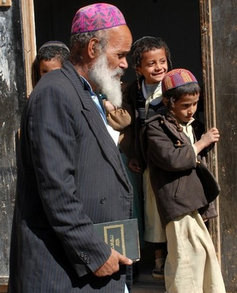 Yemeni Jewish teacher Imran Said al-Jaradi walks past some of his young students at the Shabazi Hebrew school in the village of Raydah in Amran province, 70 kilometres north of the capital Sanaa on December 14, 2008. A Yemeni former air force pilot is being held in connection with the fatal shooting of a Yemeni Jew, Masha Yaesh bin Yahya Yahuda, 28, in Raydah on December 11, the SABA Yemeni news agency reported yesterday. The small Jewish community, numbering up to a few hundred, that remains in Yemen are subject to threats and harassment, including from Islamist militants who have accused the community in the past of spreading vice and serving the interests of Zionism. AFP PHOTO/KHALED FAZAA (Photo credit should read KHALED FAZAA/AFP/Getty Images)